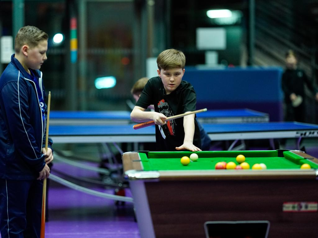 two boys playing pool